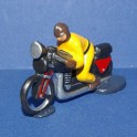 Motorbike yellow following the cycling races